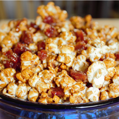 Canadian sweet and salty popcorn topped with clusters of candied maple bacon